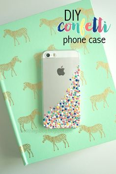 "And <a href=""http://thelilthingsblog.blogspot.com/2015/04/diy-confetti-phone-case.html"" target=""_blank"">here</a> is another DIY nail polish version to try:"
