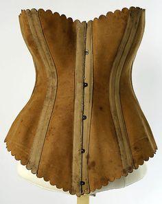"Leather corset with scalloped edges, by Maison Léoty, French, 1870-1889. Label: ""Mme Leoty, Corsets, 8 Place de la / Madeleine, Paris"""
