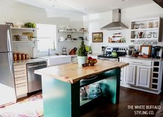 White kitchen cabinets, beadboard walls, turquoise island, live edge butcher block, open shelving, farmhouse sink