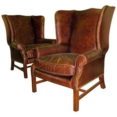 Two George III Style Wingback Chairs with Distressed Leather | From a unique collection of antique and modern wingback chairs at https://www.1stdibs.com/furniture/seating/wingback-chairs/