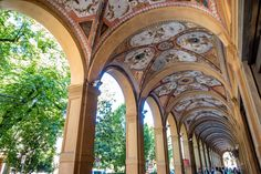 Strolling under the city's beautiful porticoes is one of the things to do in Bologna, Italy