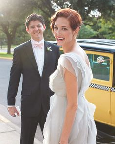 Taylor Tomasi Hill and Johnathan with a vintage cab