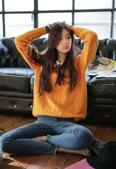 nice yellow chunky knit sweater with white shirt underneath...
