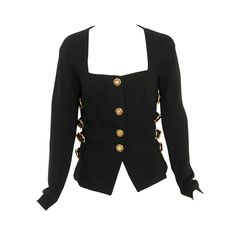 Iconic Gianni Versace Bondage Jacket Fall 1992 | From a collection of rare vintage jackets at https://www.1stdibs.com/fashion/clothing/jackets/