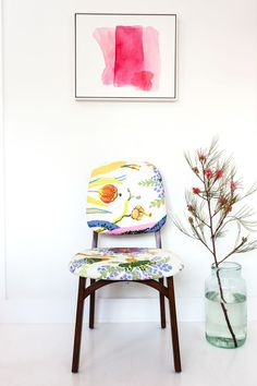 Inside Designer Irene Neuwirth's Luxe Venice Beach Home #refinery29  http://www.refinery29.com/one-kings-lane/9#slide-8  Irene found this set of dining chairs, already upholstered in a vibrant Josef Frank fabric, a decade ago. The pink watercolor is by Mary Weatherford, an L.A. artist known for her slashes of neon.