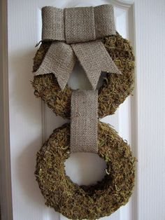 $30.00 Moss covered wreath with burlap ribbon and bow