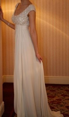 Ivory, empire-waisted evening gown, with a sequined bodice... Better in dark red!