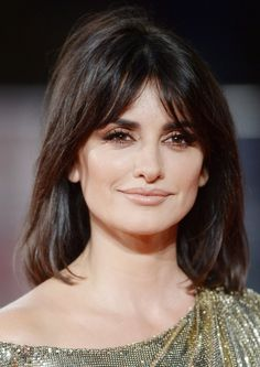 "While bangs tend to veer on the ""cute"" side of the spectrum, Penélope Cruz proves they can be super sexy, t..."