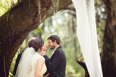 the bride + groom during their backyard ceremony. see more of this charming southern wedding here: http://www.mywedding.com/articles/hoke-and-jessis-romantic-vidalia-ga-wedding-by-bella-jay-photography/
