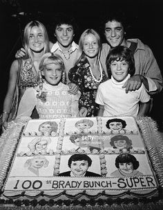 Young cast members of the television series, 'The Brady Bunch' pose with a cake celebrating the show's 100th episode, circa 1973. (L-R): Maureen McCormick, Susan Olsen, Christopher Knight, Eve Plumb, Barry Williams and Mike Lookinland