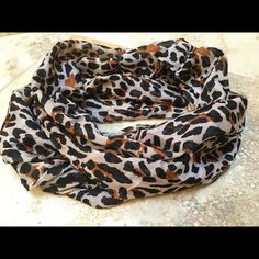 Animal print infinity scarf! Light animal print infinity scarf! Great fabric, bought at Norstrom Brass a Plum section... Tags removed. Accessories Scarves & Wraps