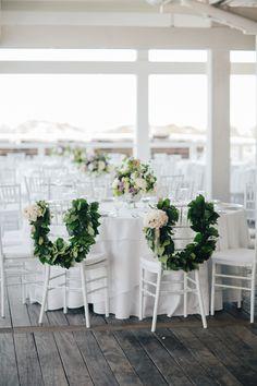 Garland accented sweetheart chairs: http://www.stylemepretty.com/north-carolina-weddings/bald-head-island/2016/03/11/romantic-beach-club-wedding/ | Photography: Julia Wade - http://julia-wade.com/