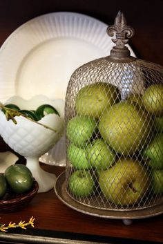 Wire cloche and green apples + milk glass <3