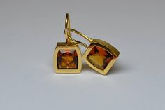 """Signed """"Cartier"""" Imperial topaz 18ct yellow gold earrings. #Imperialtopaz #cartier #Cork #amazing Imperial Topaz, Mellow Yellow, Cartier, Gold Earrings, Cork, Sunnies, Cufflinks, Amazing, Accessories"""