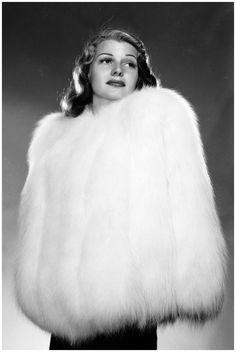 rita hayworth   Rita Hayworth encased in a fur jacket. (Photo by A. L. Whitey Schafer ...