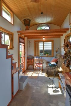 This Couple's $25k DIY Smouse Tiny House on Wheels includes vibrant colors, wood, and excellent lighting. Oh, and vaulted ceilings! | Tiny Homes