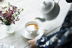 Aerial view of a woman pouring a hot tea drink. Get this free image at www.rawpixel.com
