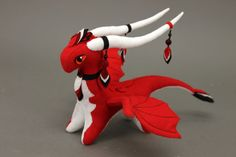 32 cm (12.6 inch) long. Soft and gentle plush dragon is a great gift and will delight your friends and family. He is so cute and playful, and he