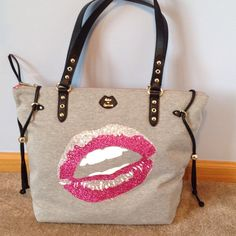 Juicy Sport Tote Gray sweatshirt material bag. Has glitter and rhinestone lips. 1 zipper compartment inside and along other side 2 pockets Juicy Couture Bags Totes