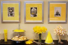 Kind of like the idea of matting photos with yellow scrapbook paper and putting them in some cheap frames. Thoughts?