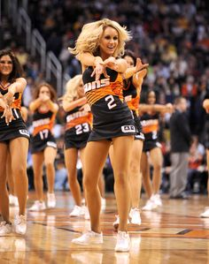 The Suns Dancers model the teams' black retro jerseys, which made their debut in a win over the Lakers on Jan. 30, 2013.