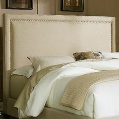 "Showcasing nailhead-trimmed linen upholstery, this lovely headboard brings a touch of elegance to your master suite.  Product: HeadboardConstruction Material: Linen and woodColor: NaturalFeatures: Nailhead detailDimensions: Queen: 60"" H x 64"" W x 2"" DKing: 60"" H x 80"" W x 2"" DNote: This product is a headboard only. Picture shows the full bed for illustration purposes only."