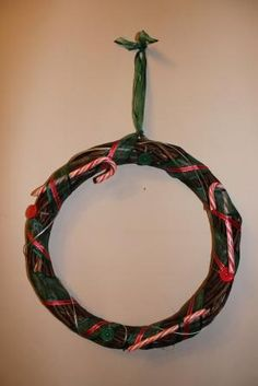 wreath ring with ribbon, buttons and candy canes