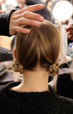 Backstage at Marc Jacobs: Redken's Guido Palau created two braided buns at the nape of the neck