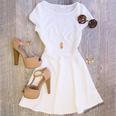 I love the simple dress! It is cut perfect no empire waist with being 53 a waistline on a dress never fits!
