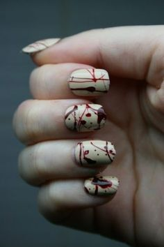 Step 1: Paint your nails White. Step 2: dribble blood (No pun intended) red paint. Step 3: With a toothpick connect the dots and make it look like a splatter.