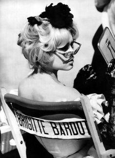 Brigitte Bardot lounging onset like a true screen starlet.