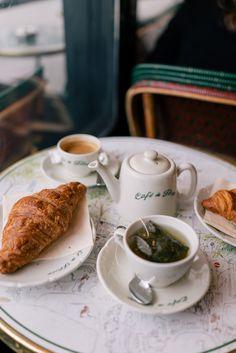 Tea and croissant at café in Paris