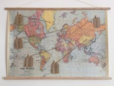 Are you having people from all over the world to your wedding or are you having a travel inspired wedding?  If so this vintage world map poster set could be a beautiful unique wedding seating plan.  Includes: - World Map Paper Poster - Pre attached wooden dowels and hanging cord - 14 Tags and pegs (if you need more tags just message us to let us know) - Twine  All you need to do is write your guests names on the tags provided and then pin the twine and tag to each destination.  Dimensions of…