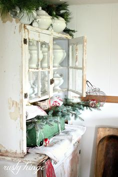 Shabby dresser full of christmas decor