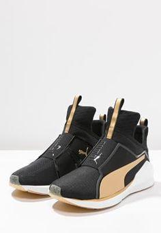 Puma FIERCE FIF - Sports shoes - black/gold - Zalando.co.uk