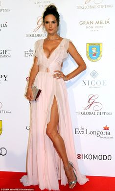 Pretty in pink: Alessandra Ambrosio looked fabulous in J. Mendel as she put on a busty show at the Global Gift Gala in Spain on July 17, 2016