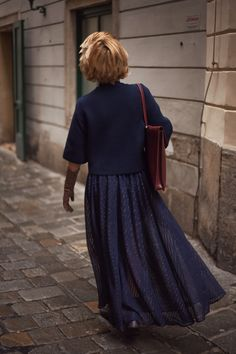 17.45 Follow Rita exploring Vienna's alleyways - wearing the A Day in a Life Navy Cropped Knitted Jumper, the Navy Full Circle Glitter Maxi Skirt and the Navy Turtleneck Ribbed Dress