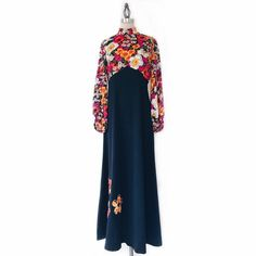 "VINTAGE | 1970s Neon Floral Maxi Dress FEATURES:  *Mock neck  *Rear invisible zipper  *Long, bell sleeves with elastic cuffs  *Bold, floral bodice with floral appliqués at hem  *100% polyester  MEASUREMENTS: Bust - 35 1/2"" Waist - 31 1/2"" Hips - 41"" Length - 53 1/2"" Best fits size 8 (will fit 6 a bit more relaxed)  ✅ Very good condition ⛔️ NO SWAPS/TRADES/RESERVES Style no. 04-025-16 Vintage Dresses Maxi"