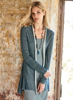 In a plaited knit of denim blue and ivory pima, our minimally styled cardigan is classic yet utterly modern, with a rolled-edge placket, slim sleeves and feminine back peplum.