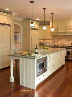 antique white cabinets with cherry floors and grey granite