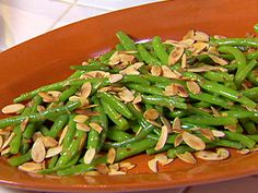 Celebrate National Almond Day with this easy side dish of green beans and our garlic almonds. 20% off all our almonds, 2/16-2./22. Coupon code: ALMOND214