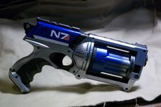 Blue MASS EFFECT inspired Nerf Maverick Steampunk SciFi Videogame N7. via Etsy. :: a certain someone said he would like this (he asked for a nerf gun painted like this instead, though. lol)