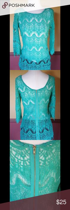 Lace 3qslv top Beautiful Teal lace top with 3 quarter sleeve length. It has a gold zipper on the back. Fabric is a cotton/nylon. Ezra Tops Blouses