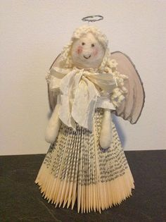 Folded book angel by LeenaH