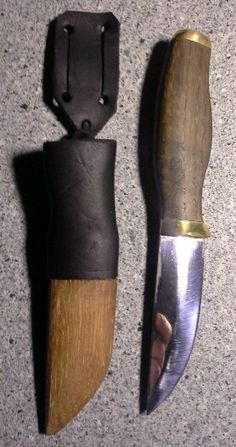 Puukko knife from Finland. Handle oak and brass, blade forged from old cultivator spring