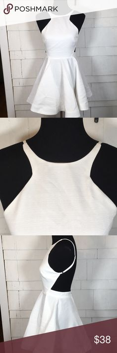 NWT white backless dress - perfect for bachelorete Beautiful white dress perfect for a bachelorette night out. Just needs a quick steam or iron on the skirt. The skirt bubbles out a little like skater style. The length from the back of the waist to the bottom is 17 1/2 inches. The straps are adjustable and all you need are some bra cups with this. It is not see-through. It is a thicker soft fabric. Polly combo.  Pure white. Fits closer to 8 than 10 hello molly Dresses Backless
