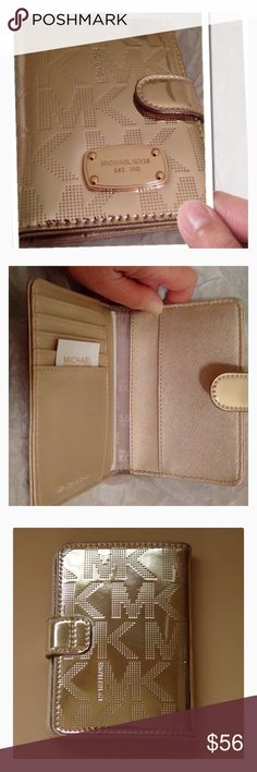 🎁Michael Kors Gold Passport & Card Holder!🎁 Pale gold passport & card holder from the Jet Set collection! Perfect holiday gift for your BFF or to treat yourself! Cover photo taken by me and framed. Includes original tag, Michael Kors booklet and insets. No box. Very small, visible only at a certain angle faint scratches on nameplate on front. They don't show up in photos. Price firm unless bundled. No Trades. This style is no longer available in stores or online. Michael Kors Bags Wallets