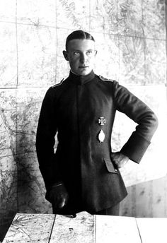 Hermann Goering stands in a map room, during World War I.