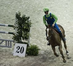 Nicola Philippaerts dressed as Nintendo game Super Mario Brothers hero Luigi competes during the Washington International Horse Show at the Verizon Center in Washington, District of Columbia. Riders competed in Halloween costumes during the gamblers choice class of the show jumping competition.