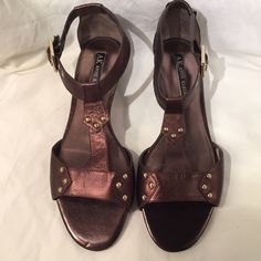 Studded Metallic T-Strap Sandal Bling + Attitude = these cute AK leather Judith bronze sandals. Unworn in original box. Sorry no trades or Paypal. Thanks for shopping by! Anne Klein Shoes Sandals